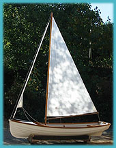 profile of sail boat with marconi sail up